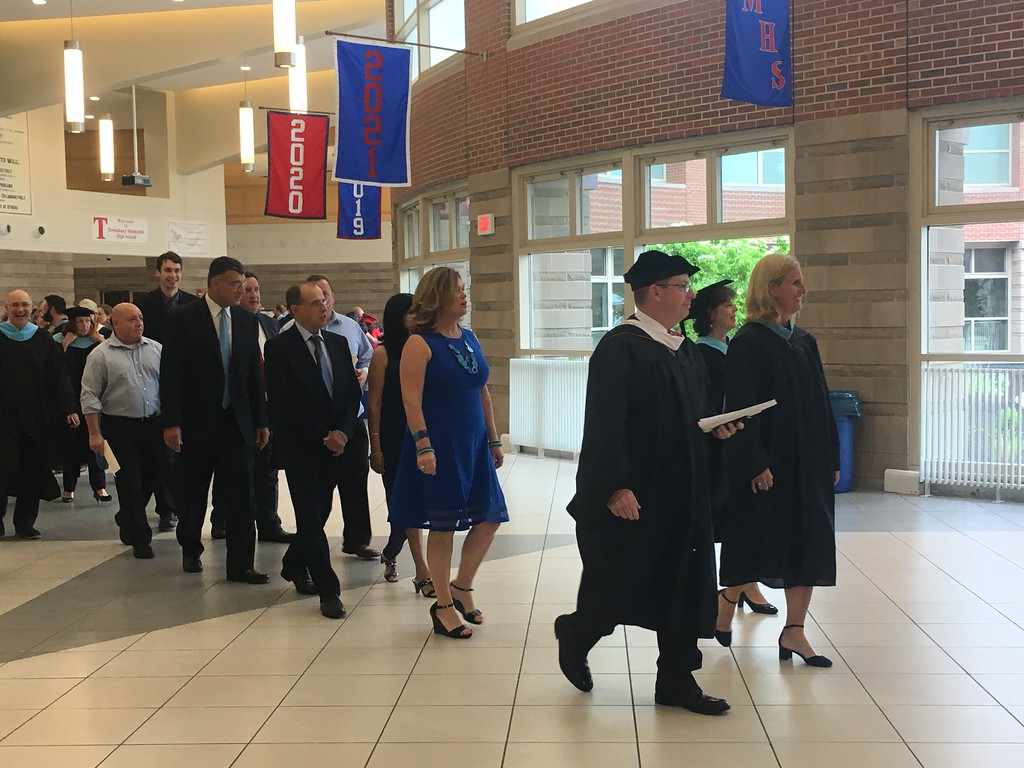 . Superintendent Christopher Malone and Tewksbury Memorial High School Principal Kristen Vogel lead the class of 2018 into the school�s gymnasium for their commencement. SUN/KORI TUITT