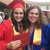 Tewksbury Memorial High School graduates Sara Krusper, left, and Grace Medina, right. SUN/KORI TUITT