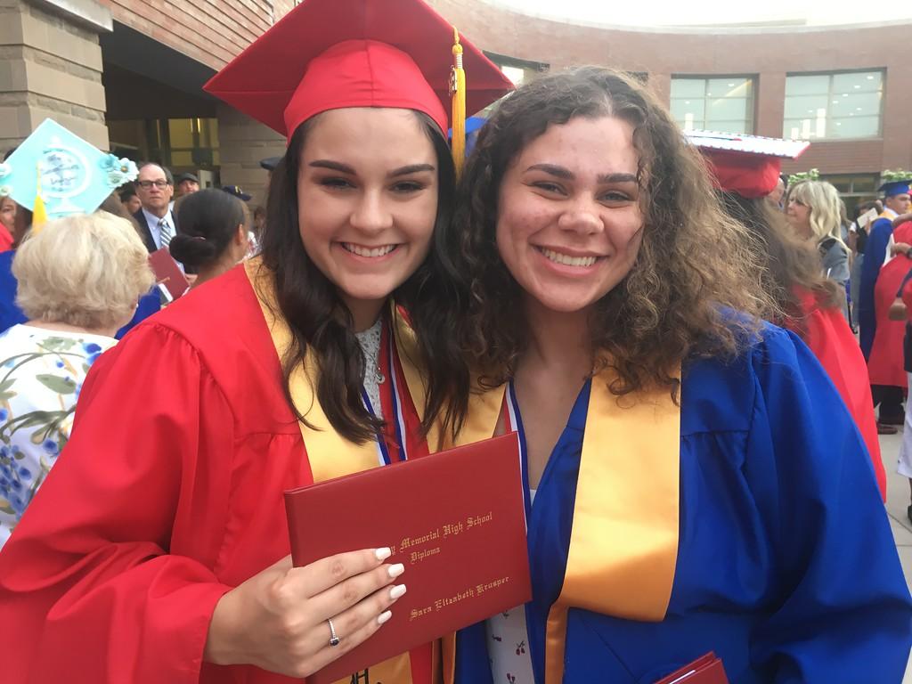 . Tewksbury Memorial High School graduates Sara Krusper, left, and Grace Medina, right. SUN/KORI TUITT