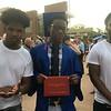 Tewksbury Memorial High School graduate Rudy Sylvestre, center, with his friends Mathew Mercedes, left, and Dukenson Emile, right. SUN/KORI TUITT