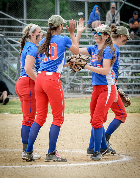 Tewksbury teammates, Aurelie Petherbridge (10) and Francesca Cocca high-five eachother during their game against Swampscott. SUN/Caley McGuane