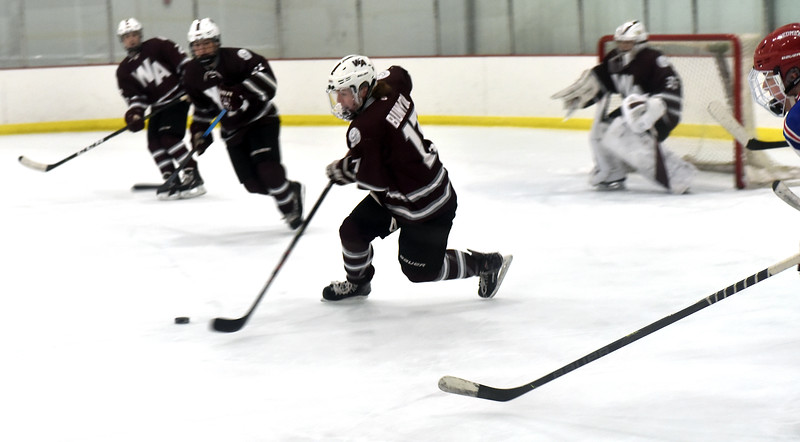 Westford's #17-Jason Bunyon, moves the puck out of Westford zone during game with Tewksbury HS. SUN/David H. Brow;