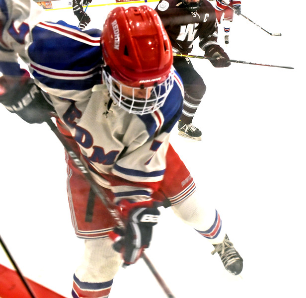 Tewksbury's #7-Ryan Flynn, works the puck away from the boards during game with Westford Academy. SUN/David H. Brow;