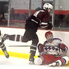 Westford Academy #9-Matthew Cielakie takes dow Tewksbury #18-Kyle Morris on the boards behind the Wesford goal. SUN/David H. Brow;