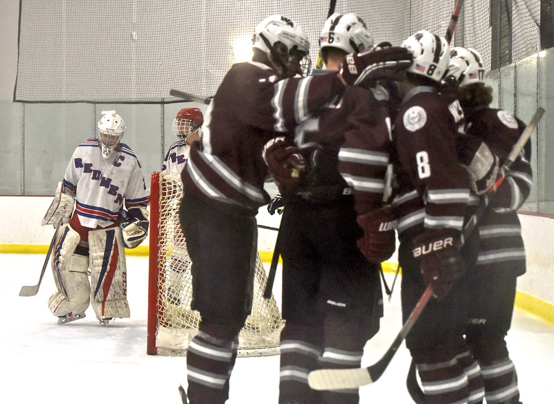 Westford Academy players celebrate after scoring their first goal in this game with Tewksbury HS. In back is Tewksbury goalie #27- Patrick Letourneau. SUN/David H. Brow;