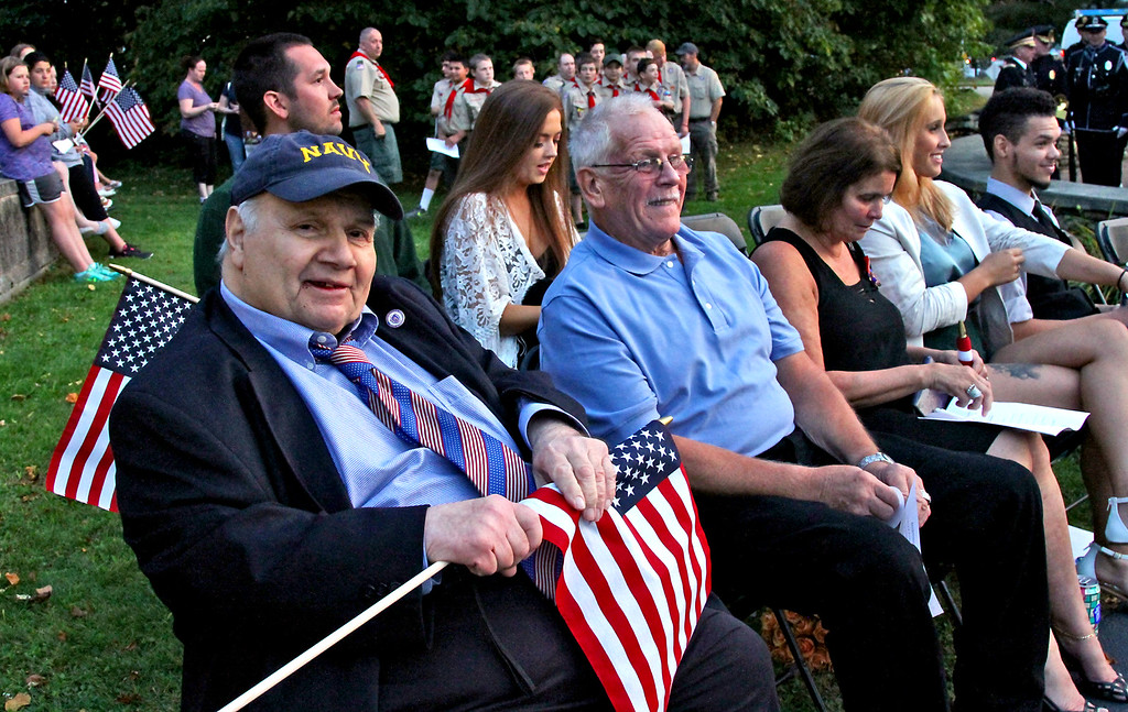. Rep Jim Miceli sits in the front with others at the start of the 9-11 Memorial in Tewksbury. SUN Photo by David H. Brow