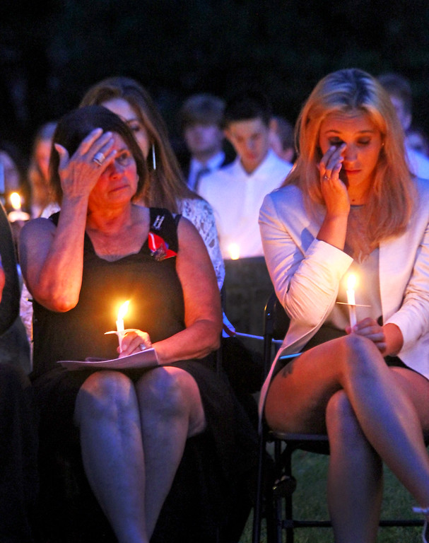 . Linda and her daughter Larissa Gay react at the Tewksbury 9-11 Memorial. SUN Photo by David H. Brow