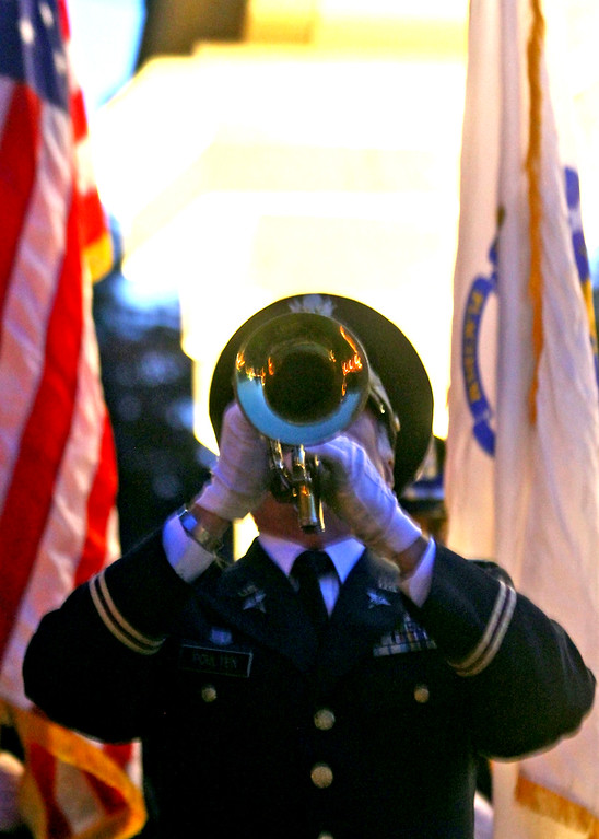 . Playing Taps is Sam Poulten of Chelmsford. SUN Photo by David H. Brow