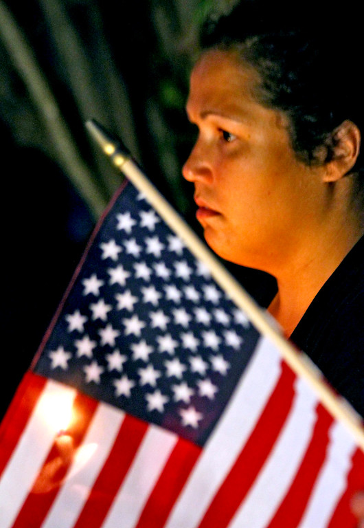 . Tewksbury resident, Jennifer Fitz-Roy, listens to the 9-11 Memorial Ceremony. SUN Photo by David H. Brow