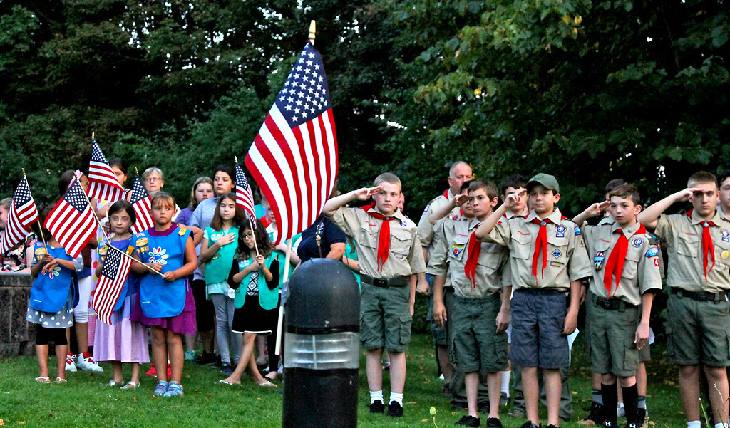 ". Girl Scouts, Cub Scouts and Boy Scouts of Tewksbury, lead the 9/11 Memorial event in the ""Pledge of Allegiance\"". SUN Photo by David H. Brow"