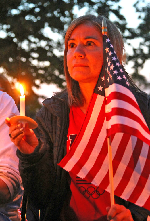 . Listing to the Tewksbury 9-11 Memorial is Cindy Nash of Tyngsboro. SUN Photo by David H. Brow
