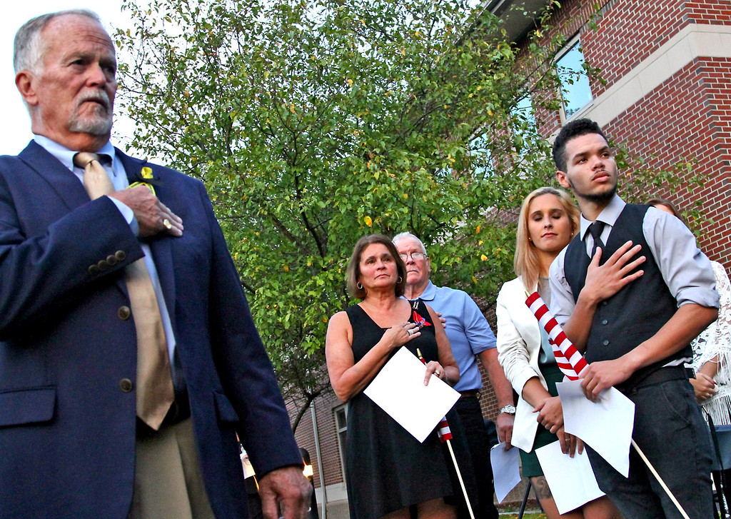 ". During the ""Pledge of Allegiance\"" at the 9/11 Memorial in Tewksbury, L-R, Robert Fowler MC/Pres. of 9/11 Comm., Linda Gay, Dennis Roaf, Larissa Gay, and Darian Wallace. SUN Photo by David H. Brow"