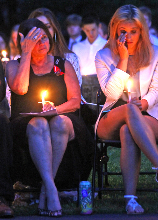 . Linda Gay and her daughter, Larissa Gay, show emotion as the Massachusetts 9-11 victims names are read by the Tewksbury Police and Fire Departments, Peter Gay(husband/father) was one of the victims. SUN Photo by David H. Brow