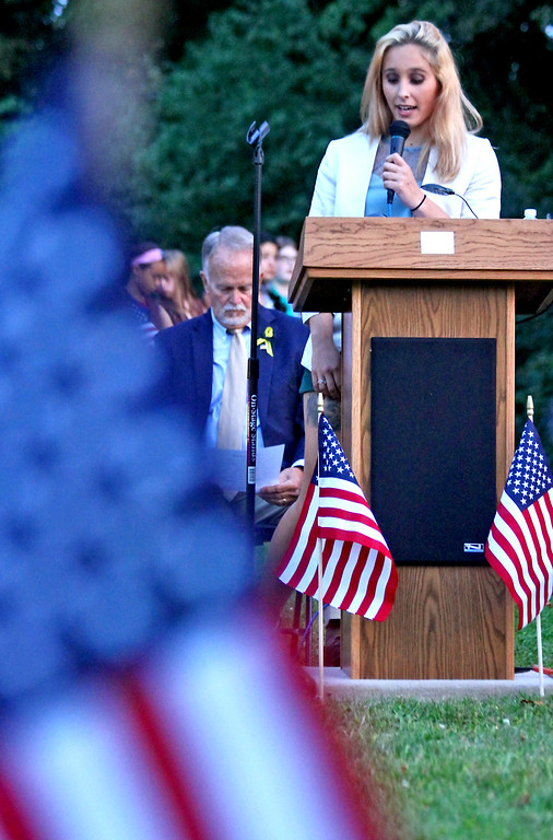 . Larissa Gay, whose father died in one of the 9-11 plane crash, speaks to the crowd at the Tewksbury 9-11 Memorial. SUN Photo by David H. Brow