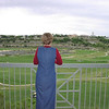 Sunday, April 20, 2003 - Wynda looking out over the Quarry Golf Course adjacent to our apartment in the Meridian on East Basse Road. We arrived in San Antonio mid-afternoon, having spent the night in Beaumont, Texas.