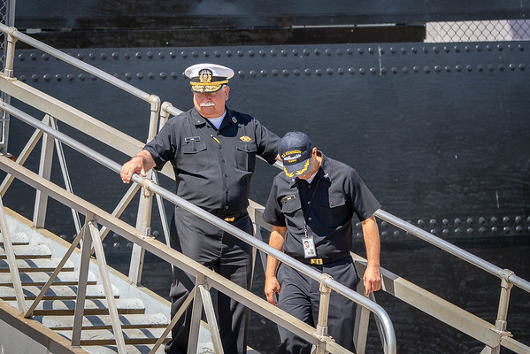 CDRE B. Lima and CAPT J. Cukor depart the vessel