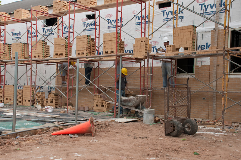 Laying the brick on the new St. Stanislaus parish hall in May 2010