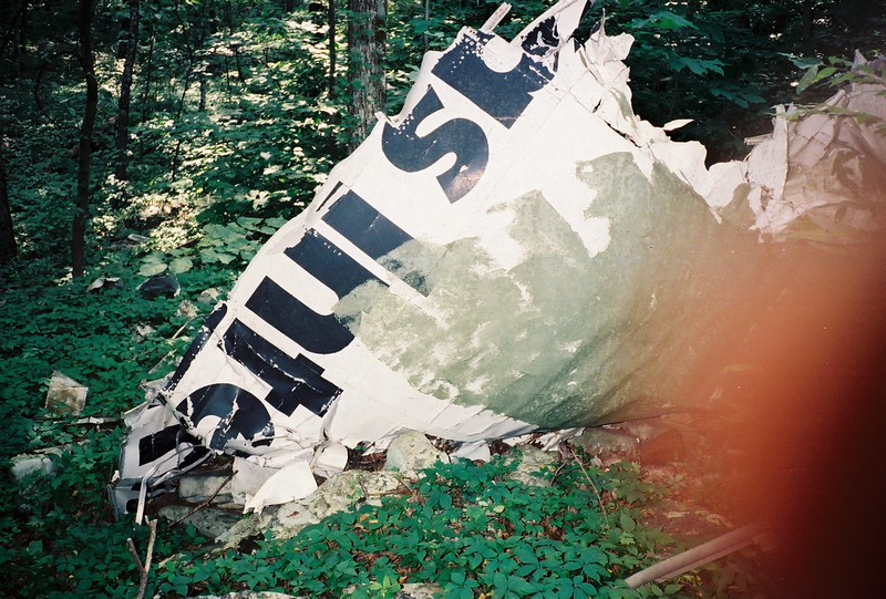 One thing that surprised me was finding evidence of someone bringing a gallon of paint and a roller to the site.  It wasn't until many years after this visit that we learned that a distraught family member attempted to camouflage the wreckage to hide it from view.