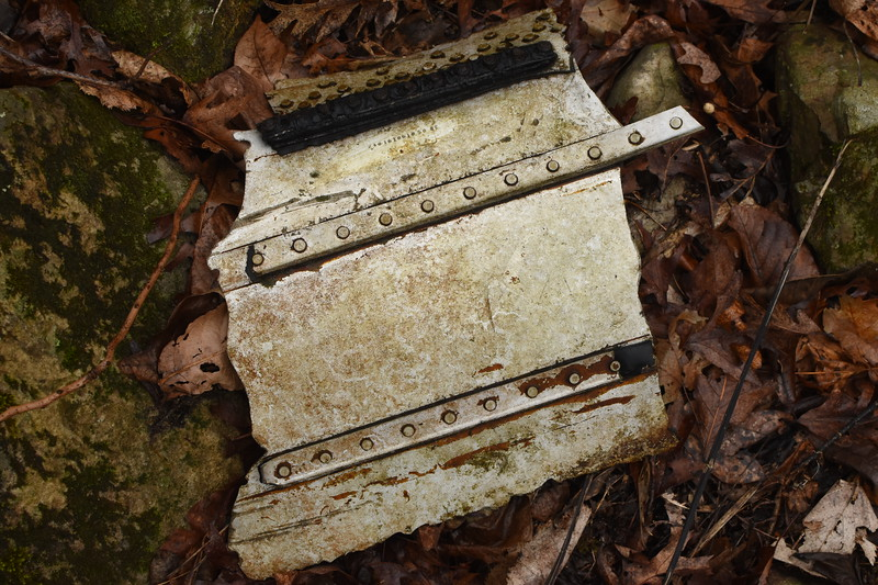 Remnants of a fuel tank access door that would have been located on the bottom of one of the outer wing sections, just outboard of the engine nacelles.