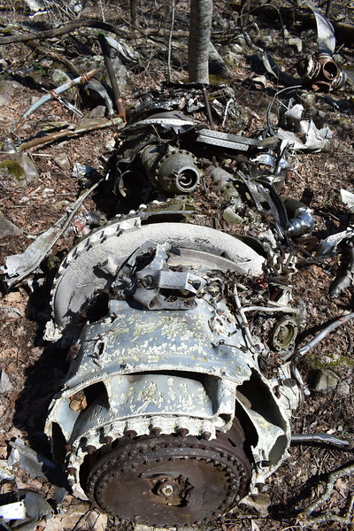 #1 engine, with its associated prop in the background.  Two blades have been removed from each prop assembly, presumably by the original NTSB investigation.  Witness marks created by the impact would have provided clues to the power settings; verifying that the engines were producing cruise power at the time of the crash.