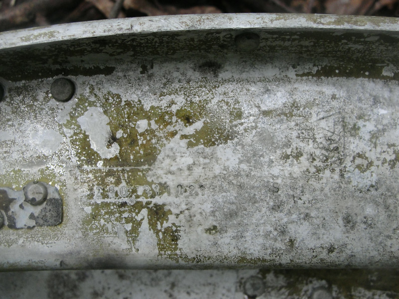 The part number and some inspection stamps were still evident on this piece of structure.