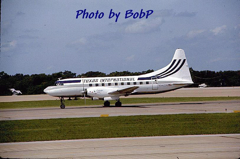 This photo, by Bob Poleneczky (used on the website with permission) shows that aircraft in the livery used by TI before the red/white/blue scheme.