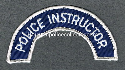 POLICE INSTRUCTOR TAB