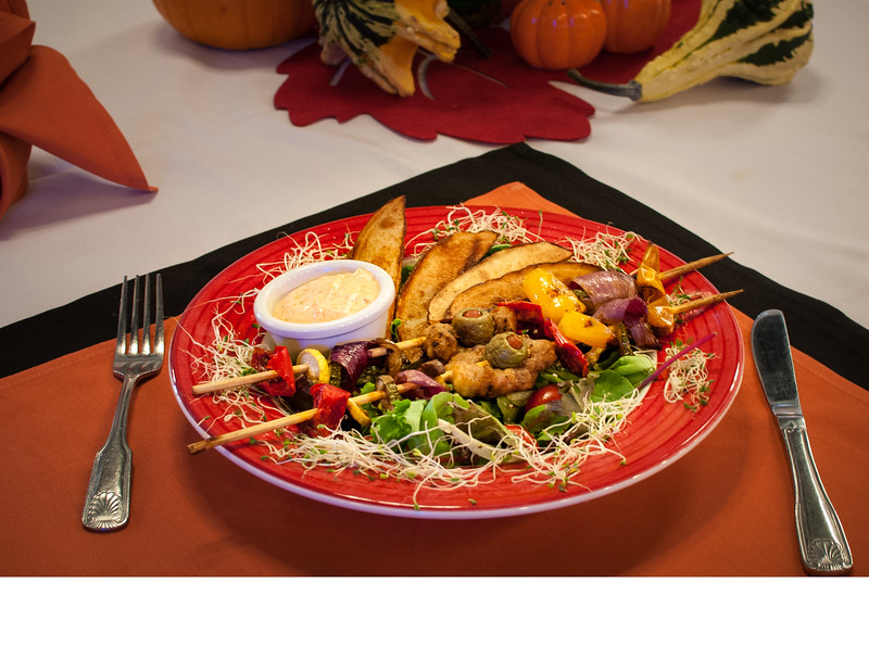 Tuesday Special - Grilled chicken breast braids on lettuce and roasted potatoes with creamy tomato soup, crisp muffins with pudding and fruit dessert and drink.
