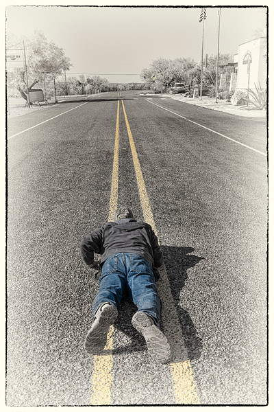 'Dead Skunk in the Middle of the Road;