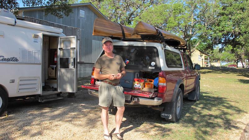 Kurt and his handmade kayak and canoe....oh, and his Shiner beer.