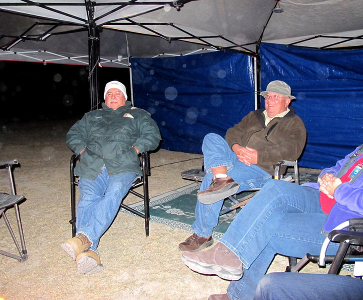 Mark Watson and Pete Marks under the tents and staying warm.