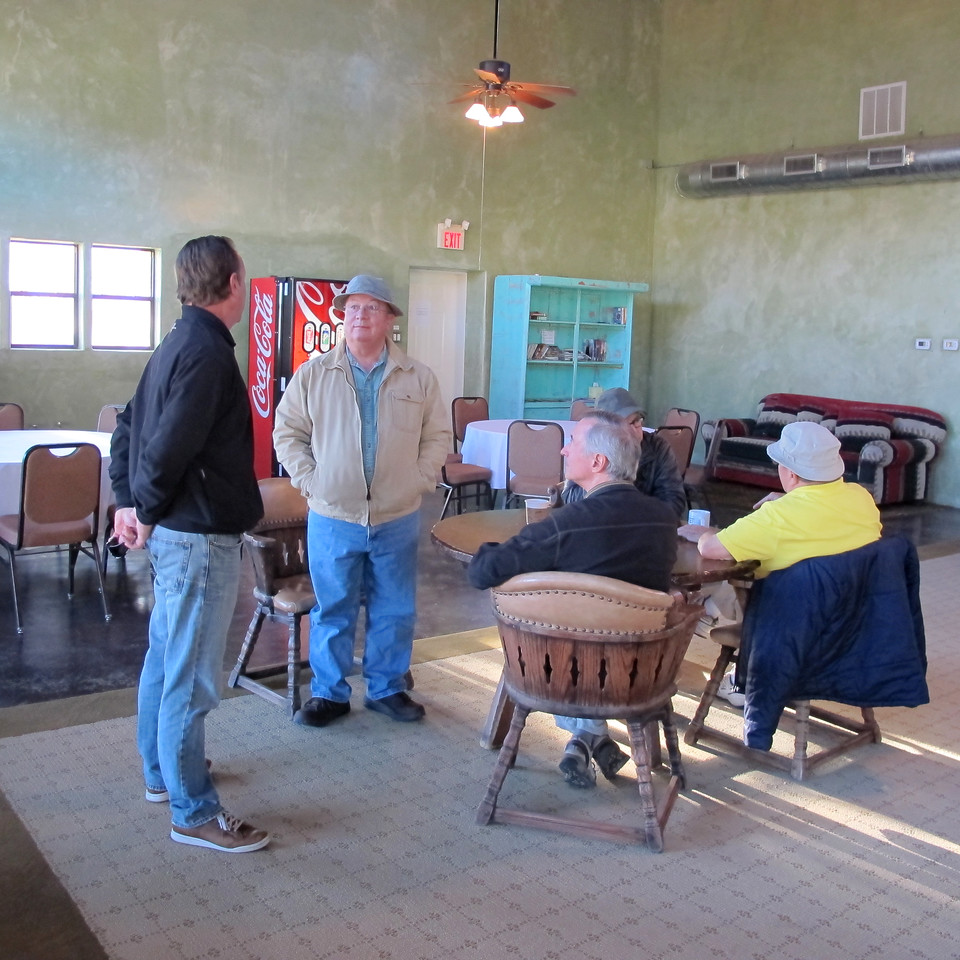 Pete Marks chats it up with RV Park Manager, Tim Garrison. At the table are Rob Torrey and George Childs.