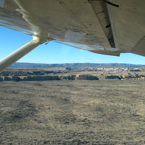 After rolling down the dirt airstrip, we're in the air!