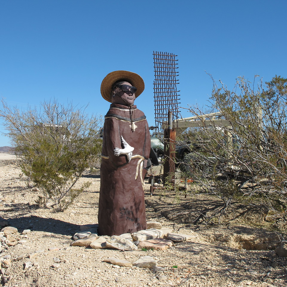 Sculpture of a 'cool' St. Francis of Assisi at the Terlingua Farmer's Market.