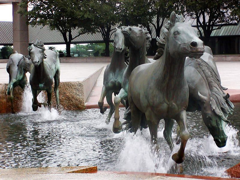 """Located at Williams Square in  Las Colinas (part of Irving, Texas) , this is the world's largest equestrian sculpture.  This piece , created by  African wildlife artist Robert Glen, took 8 years to complete and was installed in 1984.   <br /> <br /> For those of you who remember the TV series """"Dallas"""" , a few of scenes from that show were filmed there.   Also if you watch the Dallas Cowboys on TV, you're likely to catch a glimpse of this magnificent sculputre. <br /> <br /> For more information click on the link below:<br /> <br />  <a href=""""http://lascolinasmustangs.info/"""">http://lascolinasmustangs.info/</a>"""