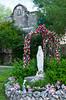 The San Jose Mission gardens and madonna statue near San Antonio, Texas, USA.