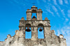 The bell tower and chapel exterior of Mission San Juan Capistrano in San Antonio, Texas, USA.