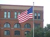 Book Depository and Flag. Oswald fired from the second window down to the right of the flagpole.
