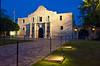The Alamo, a former  Roman Catholic Mission illuminated at night in downtown San Antonio, Texas, USA.