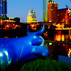 Cow statue overlooking Town Lake and downtown Austin in Austin Texas