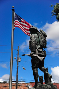 WW1 Doughboy Statue and American Flag