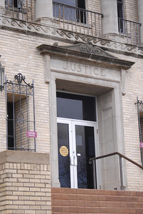 Justice Carved Above the Entrance Door