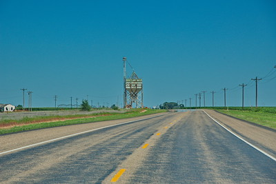 Commonly Found in the Panhandle,  Grain Elevator and Railroad Tracks