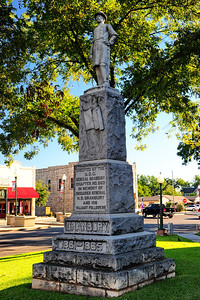 Hood County Courthouse, Granbury, Texas  Statue of the city's name sake, General Hiram B. Granbury stands in the courthouse square.