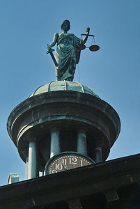 Lady Justice carries a set of scales and sword.