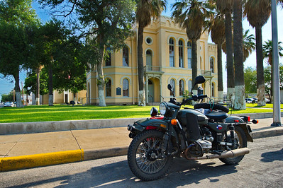 Old motorcycle in front ot the Maverick County courthouse
