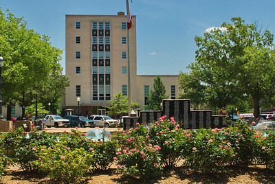 This is the courthouse in Tyler, Texas.  It is only fitting that I included some roses in the photograph.  Tyler is known for its roses and its most famous rose, Earl Campbell.