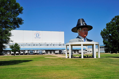Large bust of Bo Pilgrim in front ot the Pilgrim Chicken processing plant near Mt Pleasant, Texas