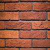 Red brick wall up close