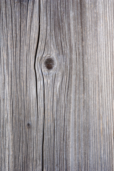 Knot in wood board, close-up --- Image by © Claudia Rehm/Westend61/Corbis